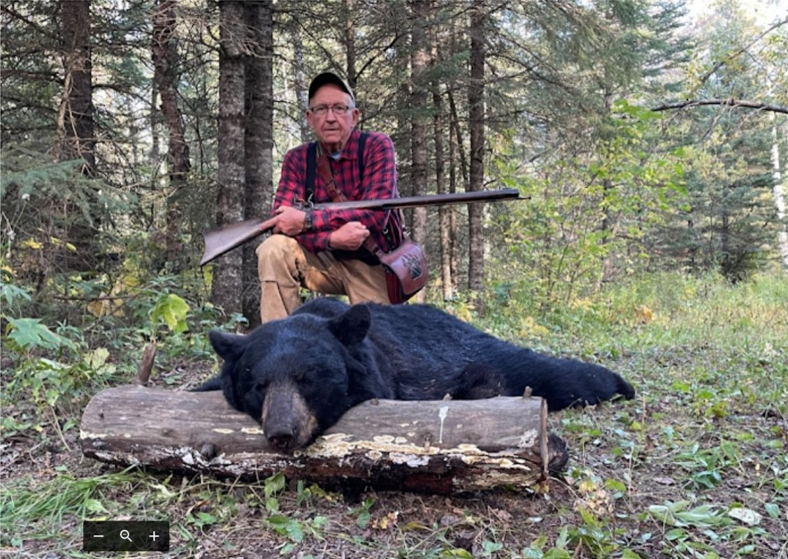 Mike and 400 pound bear with .58 flintlock.jpg